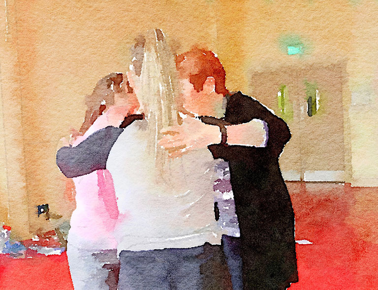 Watercolour painting of three women standing hugging each other in a circle.